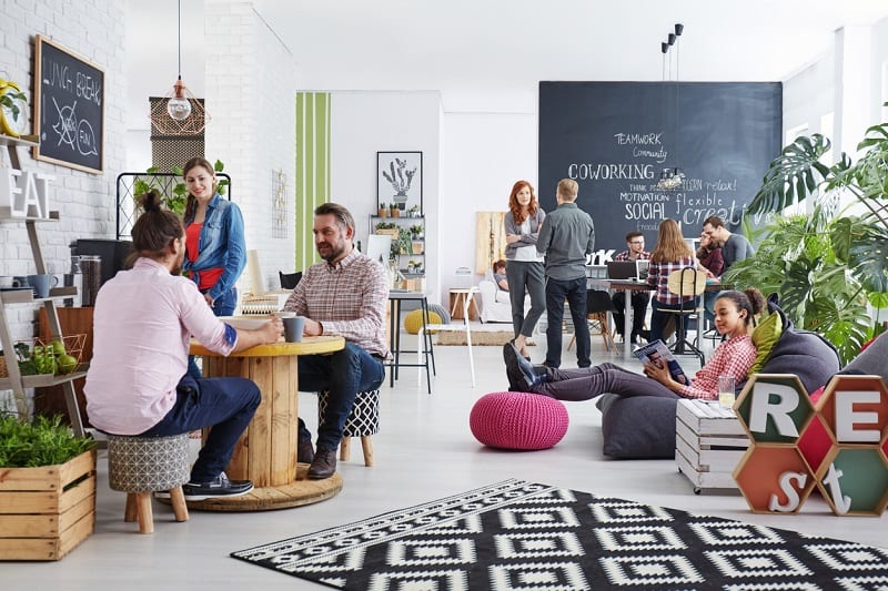 People working in modern agency relaxing during lunch break